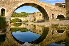 Reflection and symmetry with a medieval bridge in Lagrasse Royalty Free Stock Photography