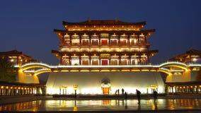 Reflection of the Tang Paradise Center at night, Xi'an, China Stock Photos