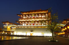 Reflection of the Tang Paradise Center at night, Xi'an, China Stock Photos