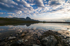Reflection on lake at sunrise Stock Photography