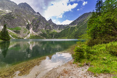 Reflection of Tatra mountains in lake Stock Image