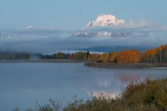 Reflection in the Tetons in Autumn at Sunrise. A sunrise reflection of the Tetons in autumn in Wyoming Stock Photos