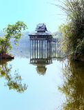 Reflection of Thai old style pavilion. Stock Image