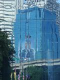 Reflection of Thailand late King Bhumiphol in building glass Stock Photo