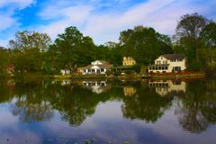 Reflection of three lake houses stock images