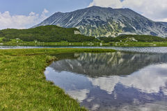 Reflection of Todorka peak in Muratovo lake, Pirin Mountain Royalty Free Stock Image