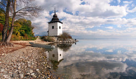 Reflection of tower at Liptovska Mara, Slovakia royalty free stock photo