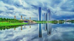 Reflection of towers at Putrajaya lake Stock Photo