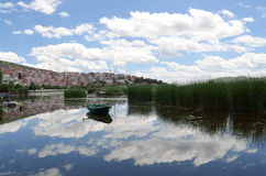 Reflection of town in lake waters Stock Photo