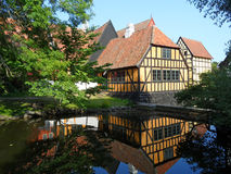Reflection of Traditional Houses of the Open-air Museum `Den Gamle By` in Aarhus. Denmark Royalty Free Stock Photography