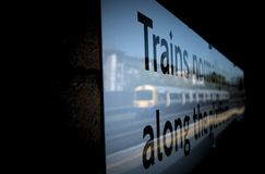 Reflection of Train Arriving Kensington Rail Station Royalty Free Stock Image