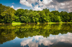 Reflection of trees and clouds in the Potomac River, at Balls Bl Stock Photo