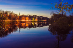 Reflection of trees in the river at evening Royalty Free Stock Image