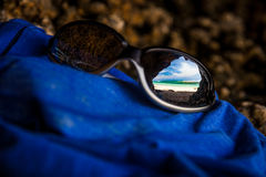 Reflection of a tropical beach in sunglasses Royalty Free Stock Image
