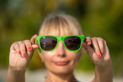 Reflection of tropical resort beach in sunglasses Royalty Free Stock Photos