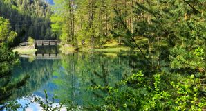 Reflection  in turquoise lake Stock Photography