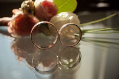 The reflection of two wedding rings in the glass stock photography