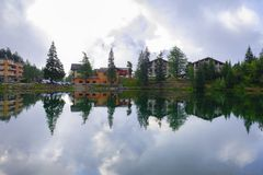 Reflection of typical Swiss landscape in a lake on a cloudy day royalty free stock image