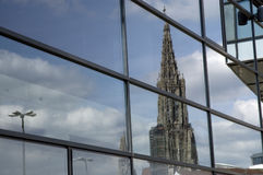 Reflection of Ulm minster. Reflection of the steeple of the cathedral in Ulm, Germany in the glass facade of a modern building Stock Photos