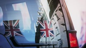 Reflection of Union Jack Flags on Regent Street a day before Royal Wedding. Cinematic reflection of Union Jack Flags on Regent Street a day before Royal Wedding stock video