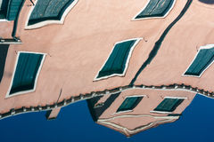 Reflection in venice canal water. Pastel color building reflection in water of venice canal Stock Images