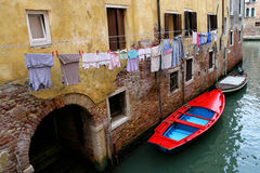 Boats moored in a canal in Venice Royalty Free Stock Photography