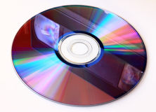 Reflection video tape to CD. Cd-rom or dvd-rom recordable side isolated on white. Reflection video tape to CD Stock Images
