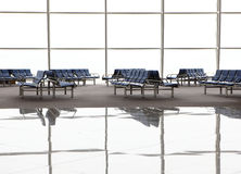 Reflection of Waiting room with blue chairs Stock Photos