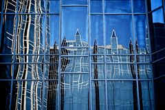 Reflection in Wall of Glass and Steel Stock Images