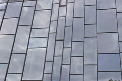 Reflection. A wall made ​​up of windows reflected the gloomy sky Royalty Free Stock Photo