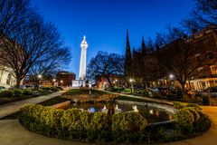 Reflection of the washington Monument from the pond in Mount Vernon Baltimore, Maryland at night stock image