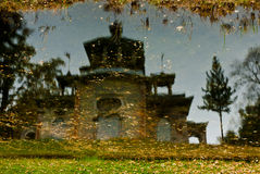 Reflection in water. Mirror picture of reflection in a pool facility. Autumn weather Royalty Free Stock Image