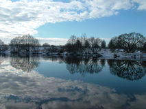 Reflection in water 3. Clouds reflectionin river, winter time stock photos