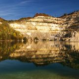 Reflection in water. Reflection of hill in a deep lake Stock Photo