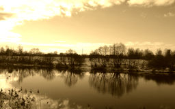 Reflection in water. Reflection in river, sepia tone Stock Photography