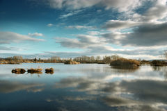 Reflection water. Small islands on the reflection water under the blue sky Royalty Free Stock Images