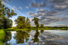 Reflection in water. Amazing lake in the late afternoon summer day Royalty Free Stock Images