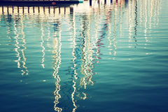 Reflection in water boats. vintage filtered image Stock Images
