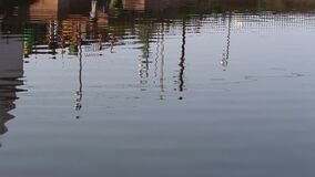 reflection of surrounding in lake water.