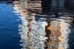 Reflection in the water of colored strips royalty free stock photo