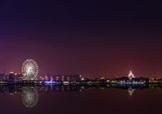 Reflection in water of the Ferris wheel at night Royalty Free Stock Photo