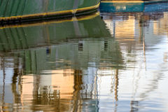 Reflection in the water of the hull of large green ocean deep se Royalty Free Stock Photo