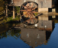 Reflection in the water of an old Grist Mill. The water wheel is standing still and no longer in use. A true reflection of time gone past. A gristmill or grist stock images