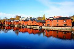View of old wood houses and reflection in water. Reflection of old houses at Porvoo city Finland Stock Photos
