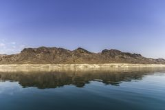 Lake Mead rock formation. Reflection in the water of the sedimentary rock formation surrounding the Lake Mead, Nevada Stock Photo