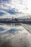 Reflection in water of the sky, on Florence Arno river. FLORENCE, ITALY - NOVEMBER 25 2015: Beautiful reflection in water of the sky, on Florence Arno river stock image