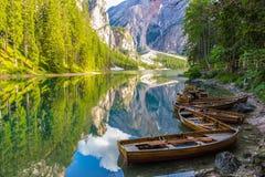 Reflection on water of wonderful Lake Braies, Italian Alps Stock Photos