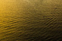 Reflection and rough wave on the sea at sunset Royalty Free Stock Photos