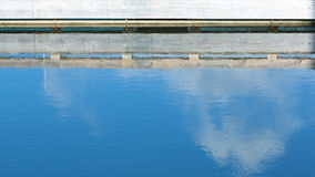 Reflection of wharf and clouds Royalty Free Stock Photo