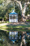 Reflection and White Gazebo Under Oak Stock Photos